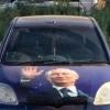 Омич украсил свой авто изображением Путина