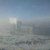 Туман с запахом гари напугал омичей