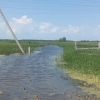 В Омской области вода подступает к огородам и домам