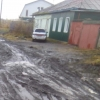 Грязно и небезопасно - омичка жалуется на дороги в Порт-Артуре