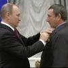 Путин наградил орденом Дружбы омского тракториста
