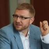 В Омске партиец Жуков обвинил Малькевича в нарушении закона