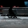 Омич на инвалидной коляске по ночам чистит парковку у гипермаркета