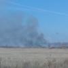 Мусорная свалка в Любино горит уже месяц
