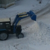 Дорожники убирают последствия предновогоднего снегопада в Омске