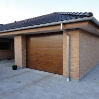 Какие ворота выбрать для частного дома