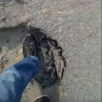 Омич высмеял разбитую дорогу по улице Депутатская