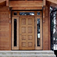 Как подобрать двери для коттеджа