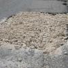 На омских дорогах сделают временные заплатки