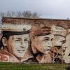 Художники подарили омичам патриотичное граффити