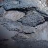 Замглавы омского Минстроя назвал причины появления ям на дорогах
