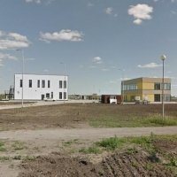 Суд разрешил компании купить землю под своей застройкой в Омске