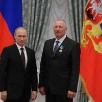 Омский тракторист получил орден из рук Путина